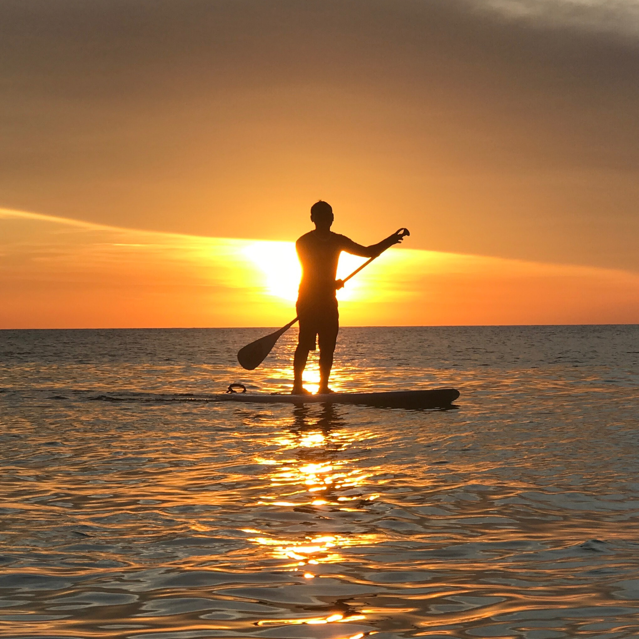 person on paddle board